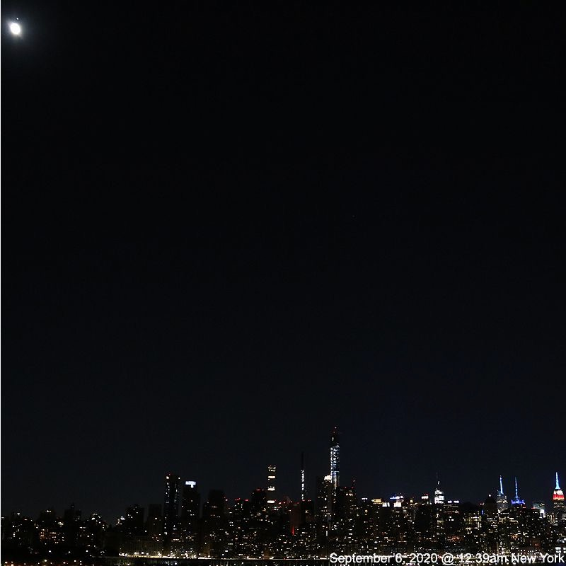 The moon and Mars over New York City.