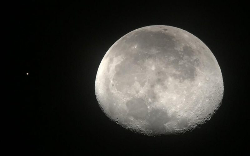 Telescopic image of the waning gibbous moon and Mars.