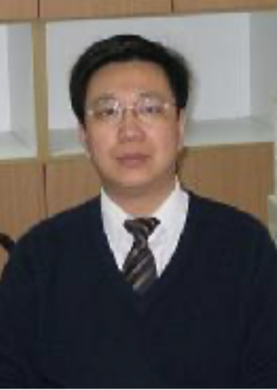 An older Chinese man with glasses, in a sweater and tie.