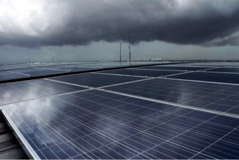 clouds over solar panels