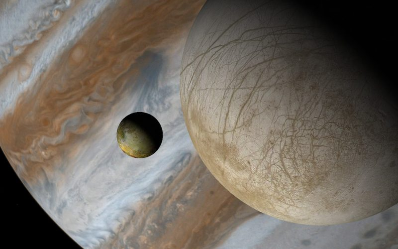 Two moons with large banded gas giant planet in background.