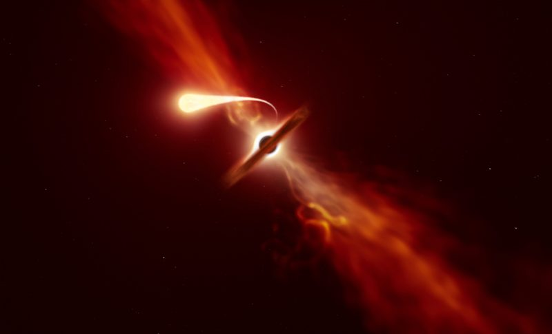 A black hole, with a disk around it and jets emanating from its poles, and with a bright flare escaping it.