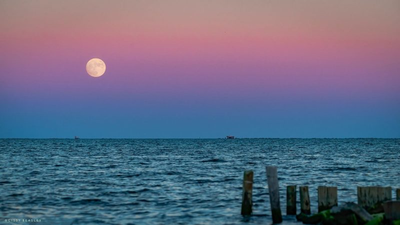 Nearly full moon rising over the Gulf of Mexico, in the midst of Earth's shadow.