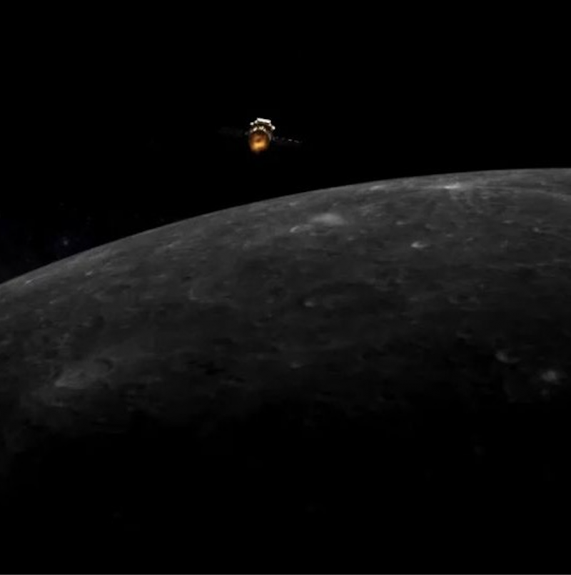 A tiny space capsule above the limb of the moon.