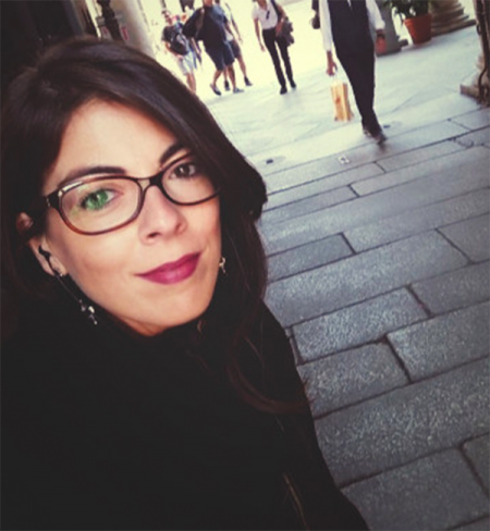 Young dark-haired woman in glasses.