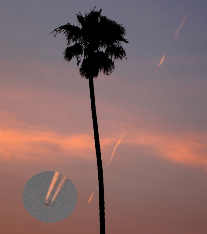Sky with pink nearly vertical trails and inset showing jetliner producing them.