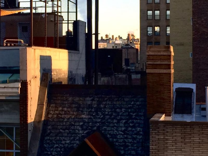 City buildings with shadows.