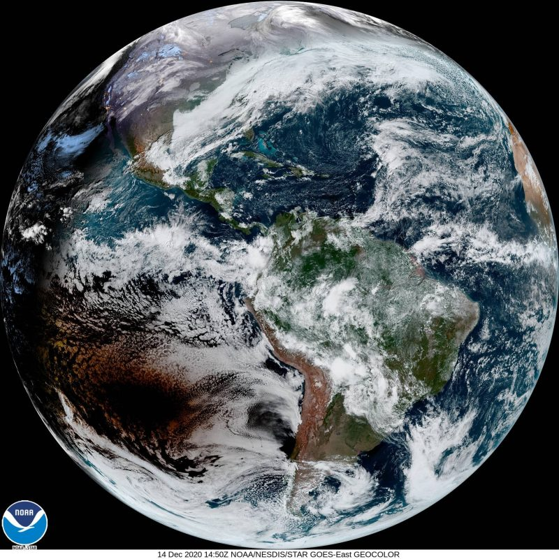 The whole globe of Earth, with a dark blot in the Pacific west of South America.