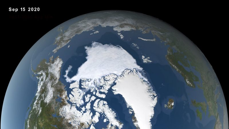 Orbital view of Arctic with large areas covered in white, surrounded by blue water.