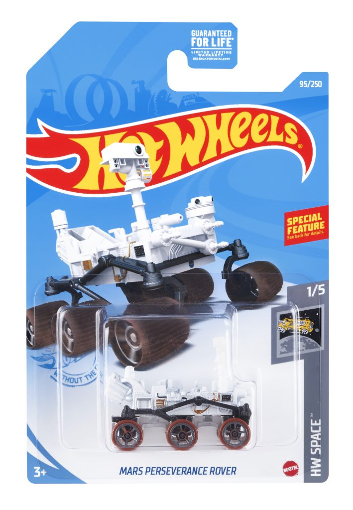 Small six-wheeled toy vehicle in plastic packaging with Hot Wheels logo.